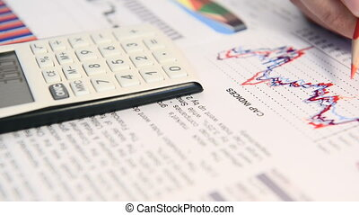 Businessman analyses financial indices