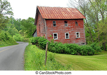 Bend in a Byway - Two story red, wooden barn sits besides...