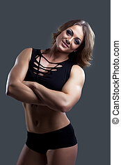 Young Athletic woman body builder portrait