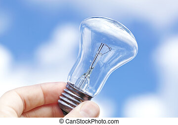 Incandescent lamp against the blue sky - An incandescent...