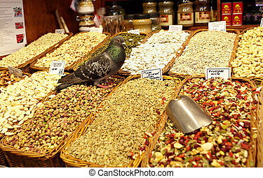 Grocery store with pigeon - Grocery store with nuts. The...