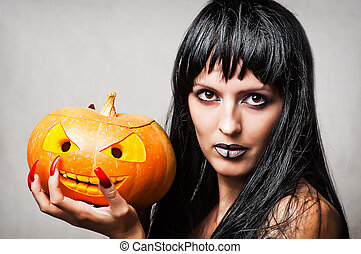 Woman witch with pumpkin - Woman witch with black hair with...