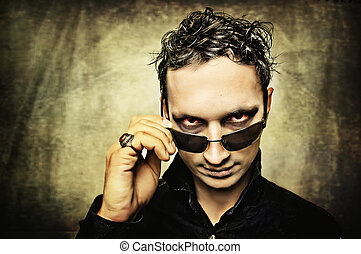 Man with evil eyes and sun glasses