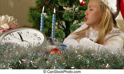 Christmas Coming - Little girl waiting for the midnight
