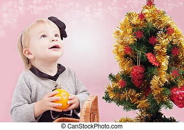 Surprised little girl under Christmas tree - Surprised...
