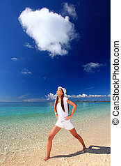 young woman on the beach enjoy sunl
