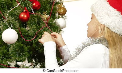 Christmas Tree Decoration - Little girl wearing Santa hat...