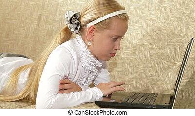Little Girl Using Laptop - Blonde little girl using laptop...