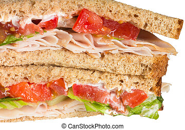 Sandwich - Close-up of turkey sandwich on whole wheat with...