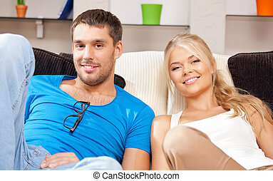 happy couple at home - bright picture of happy couple at...