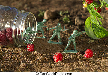 raspberrie picking - four green toy soldier protecting a jar...