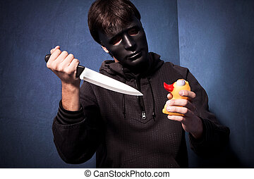 killer with mask - man with black scary mask and big knife...