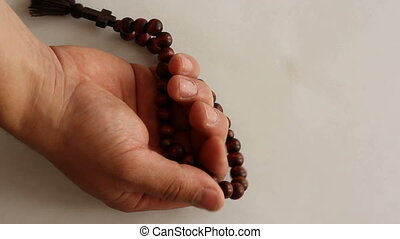 closeup of hands with rosary beads