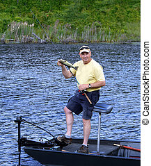 Big Smile Small Bass - Fisherman holds up his first catch of...