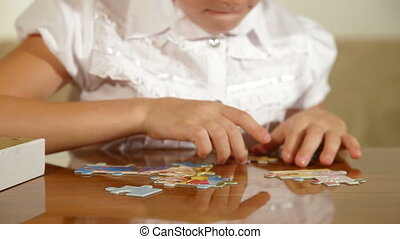 Child Assemble Jigsaw Puzzle