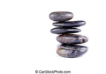 black zen stones on white backgroundt, soft shadows
