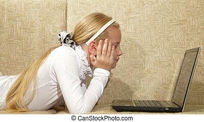 Child Watching Movie on Laptop