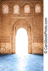 Arabesque door of Granada palace in Spain, Europe - Sunshine...