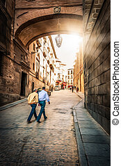 Men walking on street of Toledo, Spain, Europe. - Two men...