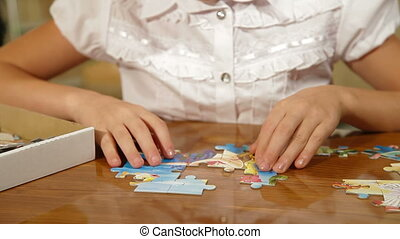 Child Assemble Jigsaw Puzzle - Little girl assemble jigsaw...