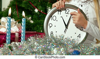 Last Seconds Before Christmas - Little girl put the clock on