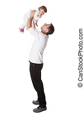 Father holding small baby aloft - Young father playing with...