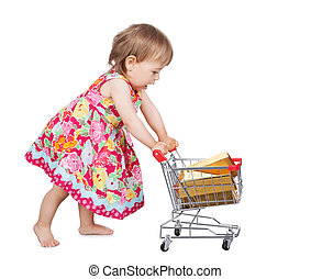 Little girl pushing a trolley - Cute little barefoot girl in...