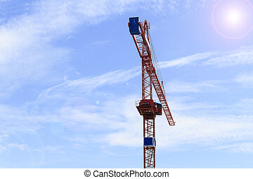 Red crane on blue sky