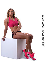 Beauty strong woman with muscle body lay