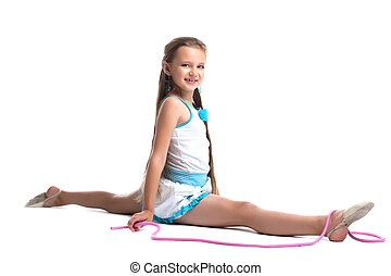 Young child gymnast doing split with skipping rope