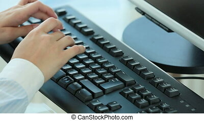 Fluent typing - Female worker typing quickly