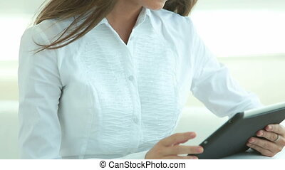 Brunette with touchpad - Attractive brunette working with...