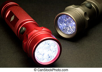 Two LED Flashlights - Turned On - Two white LED flashlights...