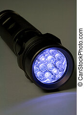 White LED Flashlight - Turned On - White LED flashlight...
