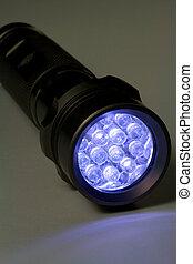 White LED Flashlight - Turned On - White LED flashlight...