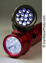 Two LED Flashlights - Turned On - Two white LED flashlights...