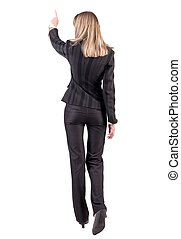 Back view of business woman walking and pointing. young...