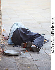 Homeless sleeping in the street - A Homeless sleeping in the...
