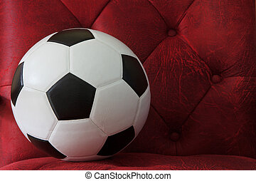 soccer football on red leather background