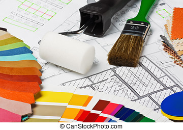 painting tools and accessories on the architectural drawings...