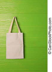 clothes bag on green background concept fot save nature...