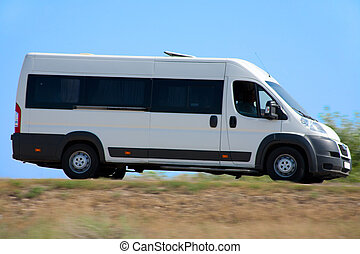 minibus goes on country highway - white minibus goes on...