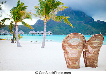 Bora Bora beach - Two chairs on a beautiful beach of Bora...