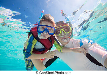 Father and son snorkeling - Underwater portrait of father...