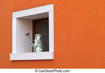 Small window with watering can