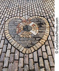 Heart made of stone pavers. The heart is situated in the...