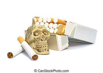 Smoking kills - An open box of cigarettes and skull