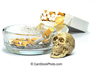 Smoking kills concept with skull next to cigarettes and...