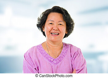 Asian senior woman - 60s cheerful Asian senior woman smiling...