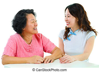 Asian family - Adult daughter having conversation with...